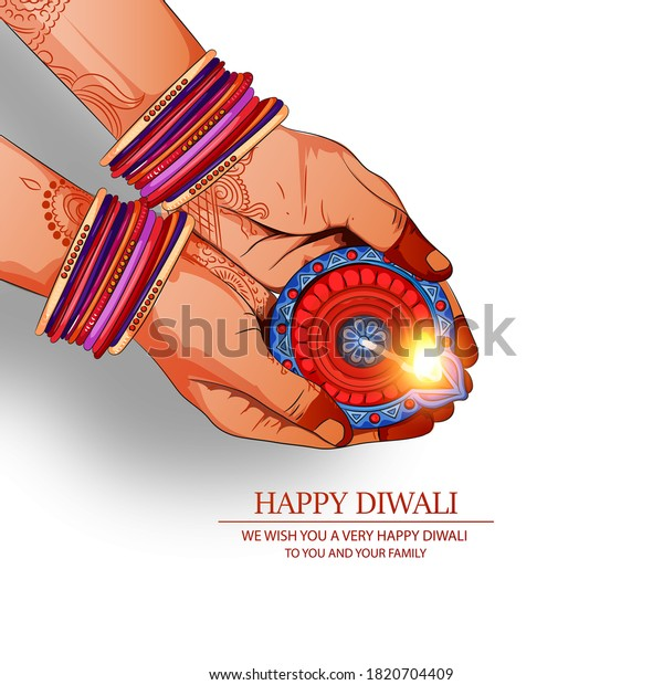 Happy Diwali Festival , Festival of lights ,Hand holding Indian oil lamp