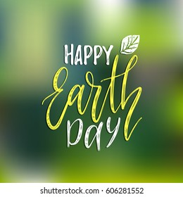 Happy Earth Day hand lettering on blurred background. Vector illustration with leaves for greeting card, poster, etc.