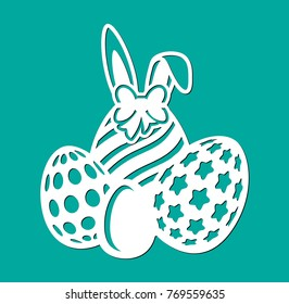 Happy Easter eggs with bow, circles, lines, stars and ears of rabbit. Laser cutting template. Vector silhouette elements. Sample illustration isolated on green spring background.
