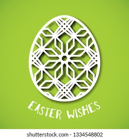 Happy Easter greeting card. Ornamental egg in paper art style on green background. Templates for laser cutting. Easter wishes