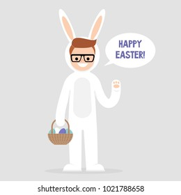 Happy easter. Young character wearing a white bunny costume and holding a basket with dyed eggs. Holidays. Flat editable vector illustration, clip art. Culture and celebrations.