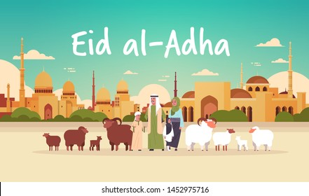 happy Eid al-Adha mubarak muslim holiday concept arab family standing with white and black flock of sheep festival of Sacrifice nabawi mosque building cityscape flat full length horizontal