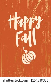 Happy Fall - hand drawn lettering phrase with pumpkin on wooden background. Harvest fest poster design. For invitation cards, banner, print, brochures, poster. Vector illustration.