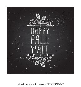 Happy Fall Y'all. Hand-sketched typographic element with acorns on chalkboard background.