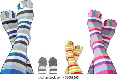Happy family in color stripy socks - mom, dad, child and cat