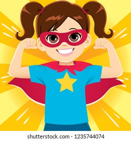 Happy funny and cute little super hero girl flexing arms showing strength