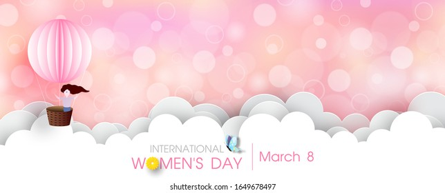 Happy girl in a pink balloon with big clouds and wording of Women's day event on blurred and bokeh pink background. International women's day greeting card in paper cut style and banner vector design.