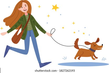 A happy girl walks the dog. The dog jumps into a puddle. woman playing with her dog in the park.