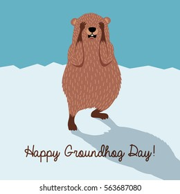 Happy Groundhog Day. Cute groundhog hiding from his shadow.