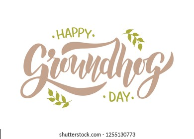 Happy Groundhog Day - hand drawn brush lettering with leaves on beige background. For poster, invitation, card, flyer, advertising, web. Vector illustration.