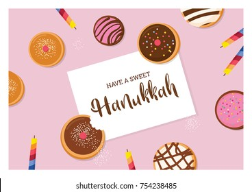 happy Hanukkah- traditional Jewish holiday . traditional doughnut  and candles