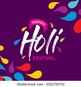 happy holi festival. holi color drops with creative typography on purple background
