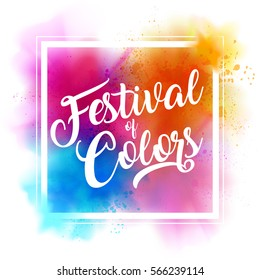 Happy Holi Indian spring festival of colors greeting vector background with editable realistic vibrant colorful Holi powder paint clouds and sample text. Blue, orange, pink and magenta powder paint.