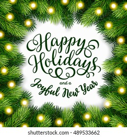 Happy Holidays hand lettering inscription with frame of fir branches