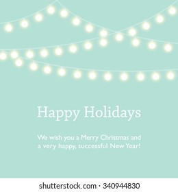 Happy Holidays, Merry Christmas and Happy New Year wishes. Mint green background with fairy lights.