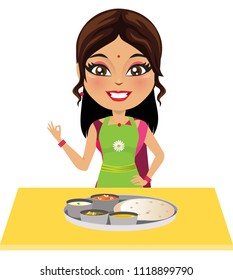 Happy Indian woman in an apron has just made wholesome Indian food