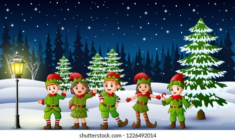 Happy kid wearing elf costume in the snowing hill