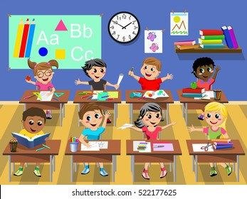 Happy kids or children sitting at desk in the classroom at school