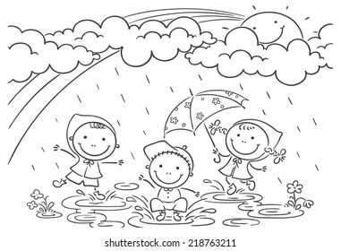 Happy kids playing in the rain