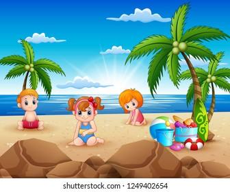 Happy kids sitting on the sand beach