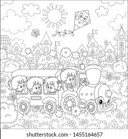 Happy little children playing in a funny toy train on a playground in a summer park of a small town on a sunny day, black and white outline vector illustration in a cartoon style for a coloring book
