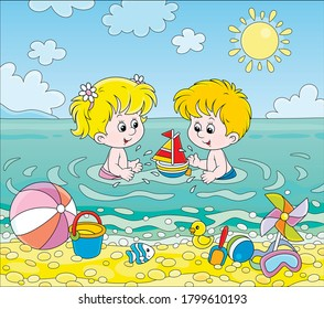 Happy little kids playing with toys in blue water on a sea beach on a sunny summer day, vector cartoon illustration