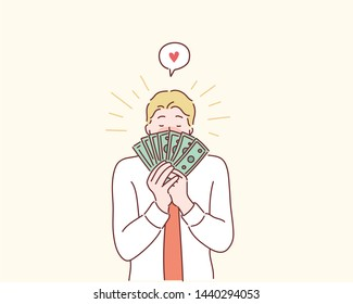 Happy man kissing dollar bill. Hand drawn style vector design illustrations.