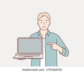 happy  man pointing finger at blank screen laptop computer. Hand drawn style vector design illustrations.