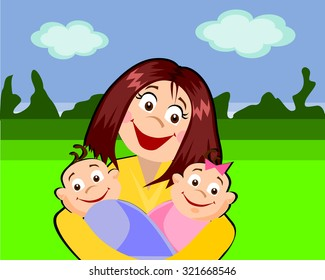 A happy mother with her baby-twins in the park