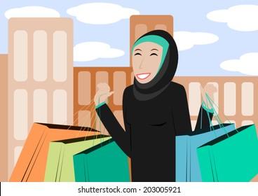 Happy muslim woman shopping outdoors