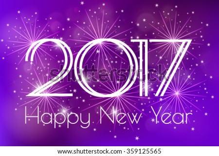 happy new year 2017 card with blue fireworks glowing fire on blurred blue purple background