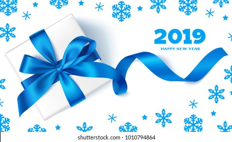Happy New Year 2019.Decorative New Year background with gift box, blue bow, snowflakes and 2019 greeting text. Winter holiday template design