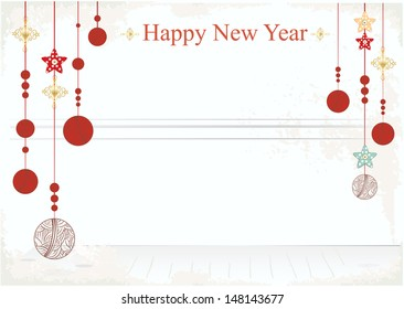 happy new year card design with hanging christmas baubles in an empty room with copyspace on