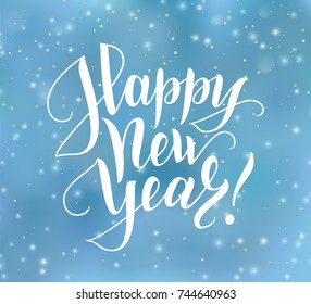 Happy New Year text, hand drawn lettering. Holiday greetings quote. Blue blurred background with falling snow effect. Great for Christmas and New year cards, posters, gift tags.