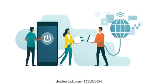Happy people disconnecting and doing a digital detox, they are unplugging the phone and being offline