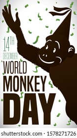 Happy primate silhouette celebrating World Monkey Day this 14th December, wearing a party hat and under a confetti shower.