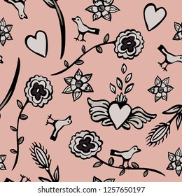 Happy and romantic Mexican folk art vector seamless pattern. Hearts, flowers and birds on a blush pink background, For celebrations, Valentines Day, birthdays and holidays in Mexican culture.