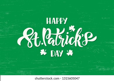 Happy Saint Patricks day celebration text with shamrock. Hand drawn brush lettering for greeting card, banner, invitation, postcard, flyer, poster. Vector illustration on green texture background