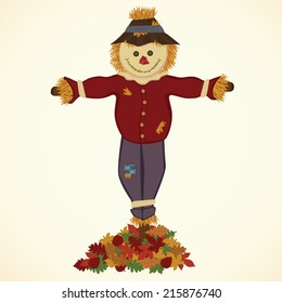Happy Scarecrow with Pile of Fall Leaves