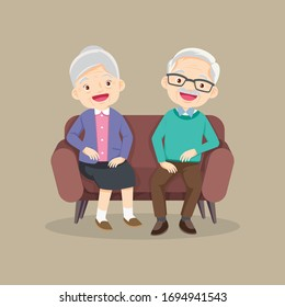 Happy senior man woman family sitting on the sofa and rest,Happy elder couple sitting,Elderly couple husband and wife sitting on couch embracing