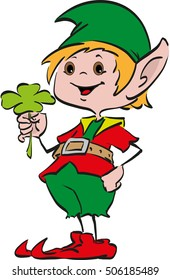 Happy smiling boy Christmas Santa's elf holding a four-leaf clover  in his hand