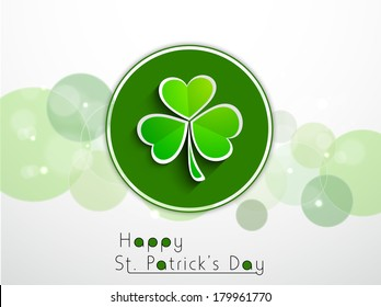 Happy St. Patrick's Day celebrations sticker, tag or label design with Irish lucky shamrock leaves on grey background.