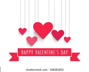 Happy Valentine's Day celebration with pink hanging hearts and ribbon on white background.