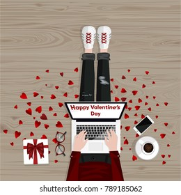 Happy Valentine's Day. Freelancer sitting on a floor and typing on laptop. Mobile phone, cup of coffee and gift box. Flat style vector illustration. Freelance concept.