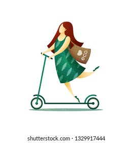 Happy woman in a green dress and with a biodegradable eco bag on her shoulder riding a scooter