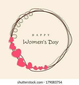 Happy Women's Day celebrations concept with heart shape decorated frame on brown background.