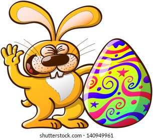 Happy yellow Easter bunny celebrating how beautifully decorated and big is his Easter Egg