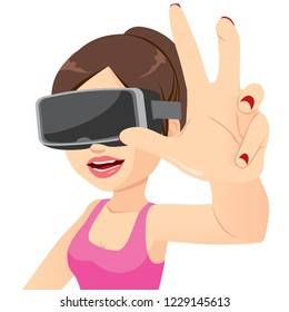 Happy young woman enjoying virtual trying to grasp something headset experience