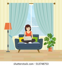 Happy young woman is relaxing on comfortable couch and using laptop at living room. Vector flat illustration