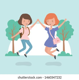 happy young women celebrating jumping in the forest landscape